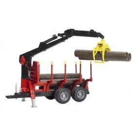 Remorque forestière avec bras de chargement à pince